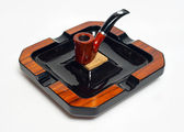 Pipe and ashtray — Stock Photo