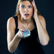 Woman with remote control — Stock Photo #20425245
