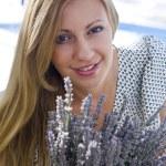 Girl holding lavender — Stock Photo #20429861