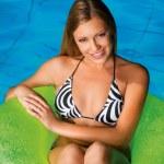 Girl in the pool — Stock Photo #20429947