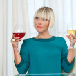 Woman choosing betwean red and white wine — Stock Photo