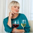 Woman with glass of red and white wine — Stockfoto