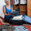 Woman packing clothes — Stock Photo #20438745