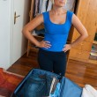Woman packing clothes — Stock Photo #20438867