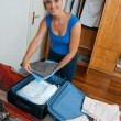 Woman packing clothes — Stock Photo #20438951