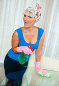 Woman cleaning glass table — Stock Photo