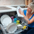 Attractive woman washing dishes — 图库照片