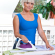 Attractive woman ironing — Stock Photo #20445203