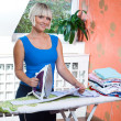 Attractive woman ironing — Stock Photo