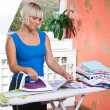 Attractive woman ironing — Stock Photo #20445895