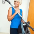 Attractive woman holding vacuum cleaner — Stock Photo #20446109