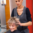 Photo: Stylist drying woman hair
