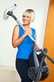Attractive woman holding vacuum cleaner — Stock Photo