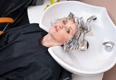Woman with coloring foil — Stock Photo