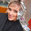 Woman with coloring foil — Stockfoto