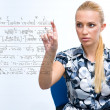 Woman solving math problem — Stock Photo #20463031