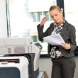 Stock Photo: Woman working on copy machine