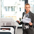 Stock Photo: Womworking on copy machine