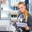 Woman secretary with copy machine - Stock Photo