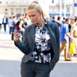Sophisticated woman with mobile phone — Stock Photo #20464949