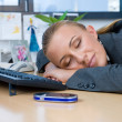 Businesswoman sleeping at her desk — Stock Photo