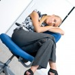 Businesswoman relaxing in the chair — Stock Photo #20465683