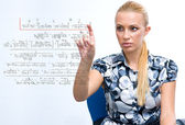 Woman solving math problem — Stock Photo