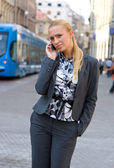 Sophisticated woman with mobile phone — Stock Photo