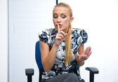 Woman making shush sign — Stock Photo
