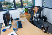 Businesswoman relaxing in the chair — Stock Photo