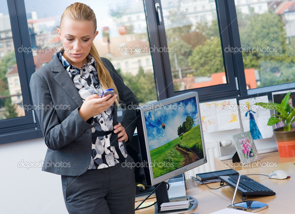 Stressed business woman with mobile phone working in office — Stock Photo #20467959