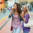 Woman friends with ice cream — Stock Photo