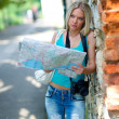 Tourist with map — Stock Photo