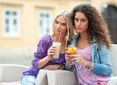 Woman friends at cafe — Stock Photo
