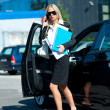 Business woman exit her car — Stock Photo #21421689