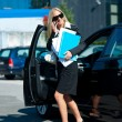 Business woman exit her car — Stock Photo #21421719