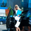 Business woman exit her car — Stock Photo #21421949