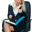 Business woman sitting in office chair — Foto Stock