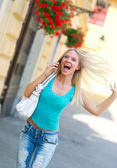 Exited woman with mobile phone — Stock Photo
