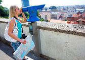Woman tourist and panorama binoculars — Stock Photo