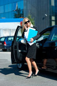 Business woman exit her car — Stock Photo