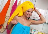 Teen girl in bathroom — Stock Photo
