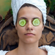 Woman face with cucumber mask — Stockfoto