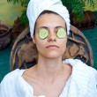 Woman face with cucumber mask — Stock Photo #21443117