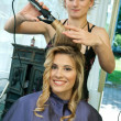 Foto Stock: Curling hair