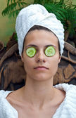 Woman face with cucumber mask — Stock Photo