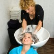Hair stylist at work - Stock Photo