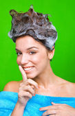 Woman with shampoo foam on her hair — Stock Photo