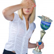 Foto Stock: Woman with trophy full of money