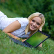 Happy woman with laptop outside — Stock Photo #22201589